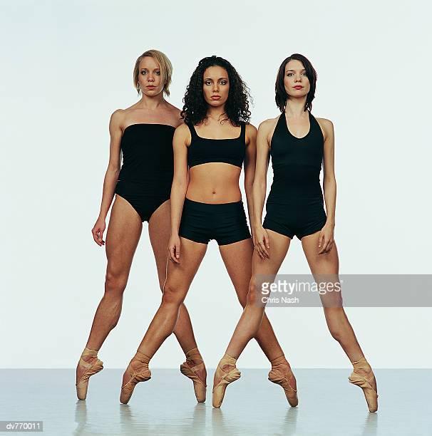 Three Female Ballerinas Standing on Tiptoe
