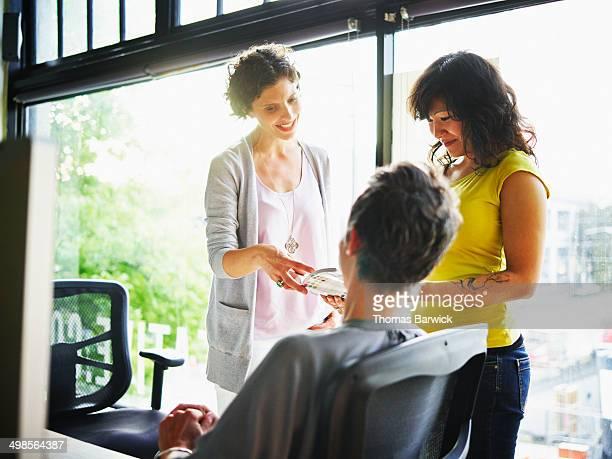 Three female businesswomen discussing project