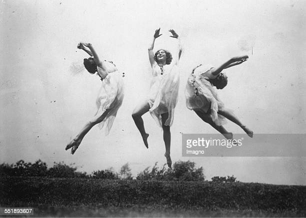 Three female dancers from Los Angeles dancing on a meadow. 23th July 1929. Photograph.