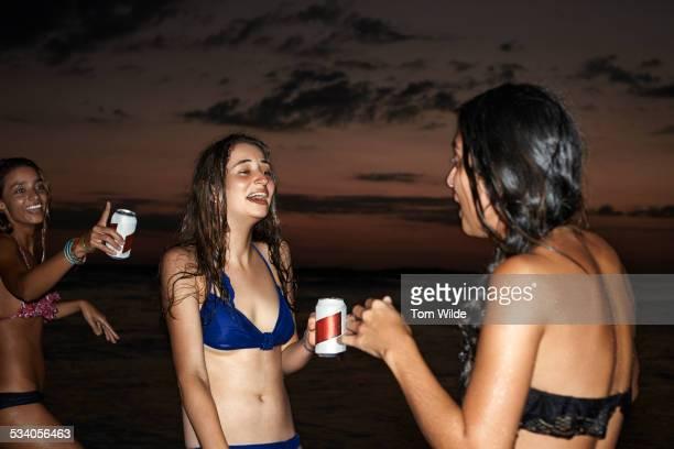three female friends laughing together - chica borracha fotografías e imágenes de stock