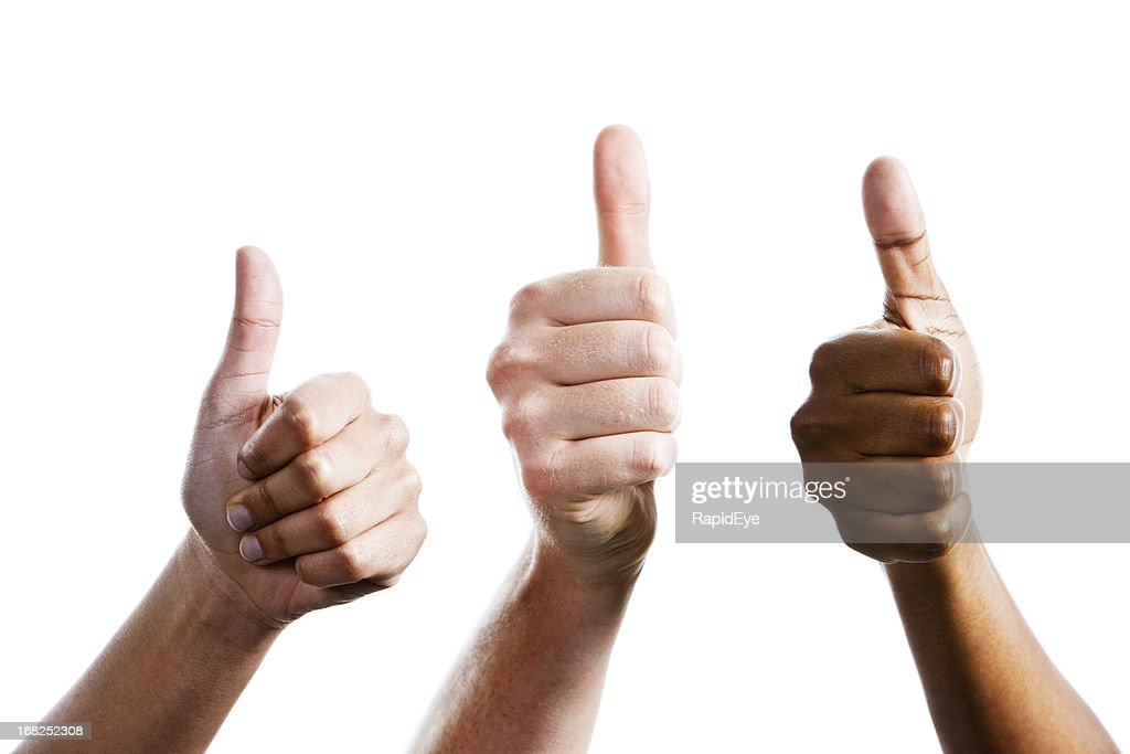 Three female hands give joint thumbs up : Stock Photo