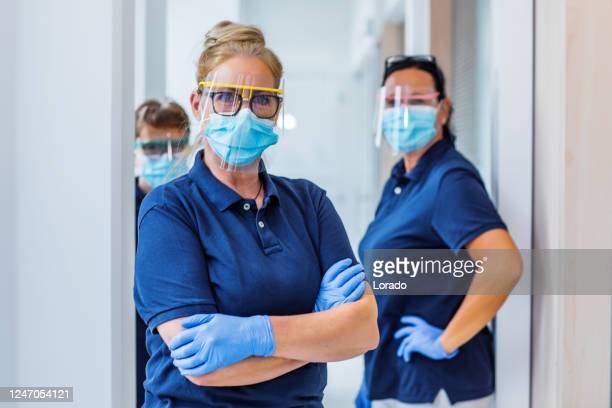 three female medical assistants in a surgery - care stock pictures, royalty-free photos & images