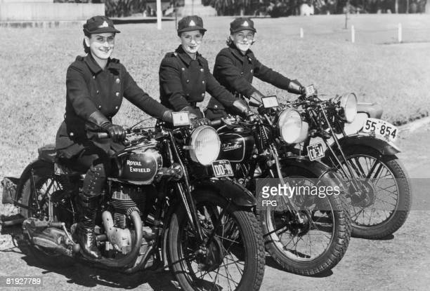 Three female motorcycle messengers of the National Emergency Services in New South Wales, Australia during World War II, circa 1943. Members of the...
