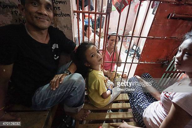Three female prisoners inside the police detention center at Isabela City await their hearings March 27 2015