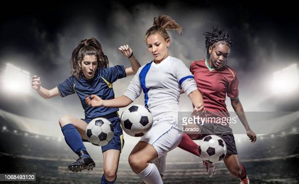three female soccer players - soccer competition stock pictures, royalty-free photos & images