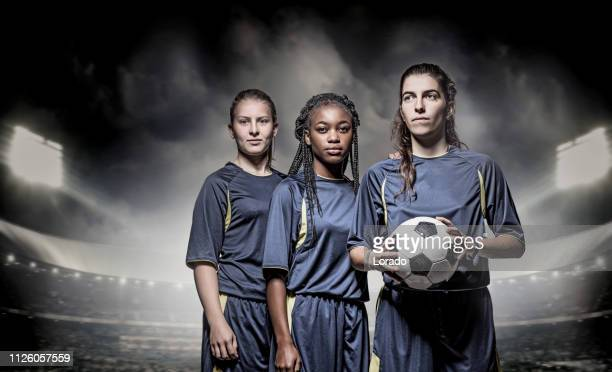 three female soccer players - women's football stock pictures, royalty-free photos & images