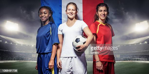 three female soccer players with french flag - campionato mondiale di sport foto e immagini stock