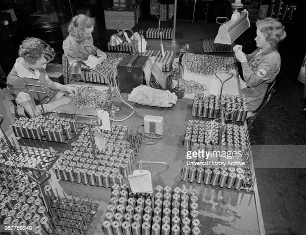 Three Female Workers Inspecting Tappet Rollers for Airplane Motors at Manufacturing Plant Pratt Whitney East Hartford Connecticut USA Andreas...