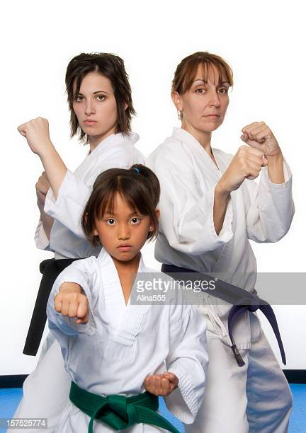 Three females in martial arts uniforms