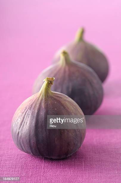 Three figs on purple cloth
