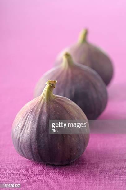 Three figs on purple cloth