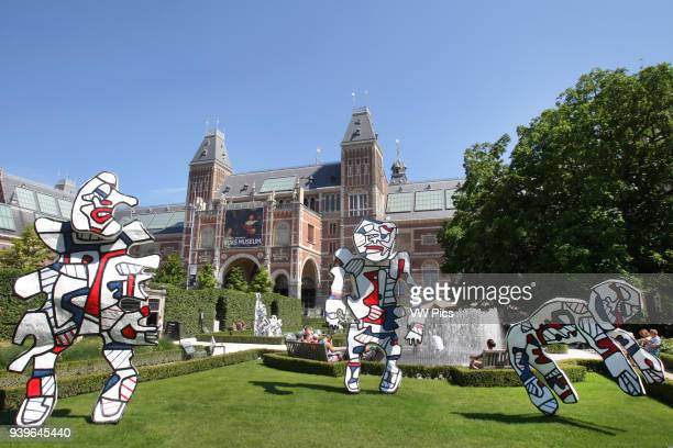 Three figures in the series LÕIncivil of the French artist Jean Dubuffet are seen in the gardens of the Rijksmuseum during open air exhibition on...