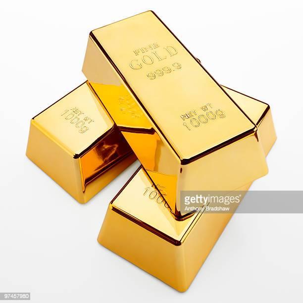 Three fine gold ingots