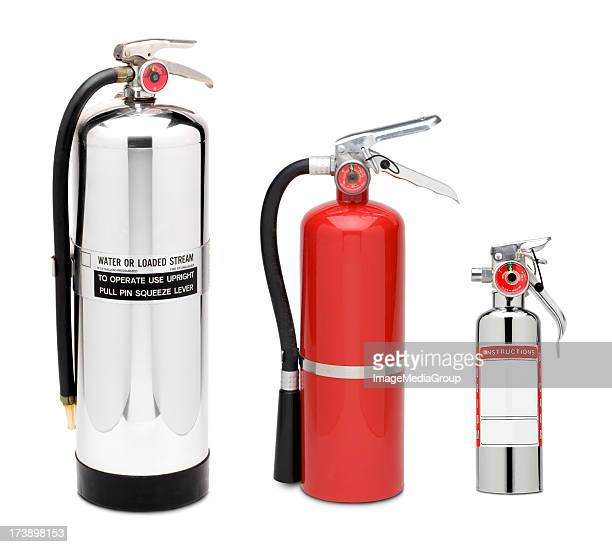 three fire extinguishers - fire extinguisher stock photos and pictures