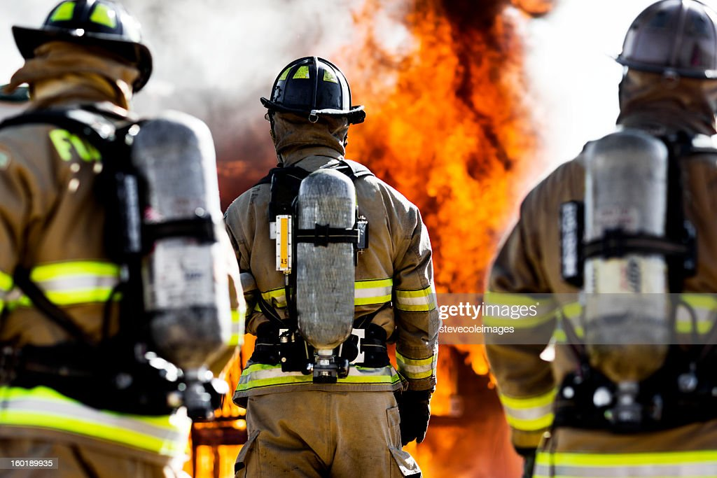 Three Firefighters : Stock Photo