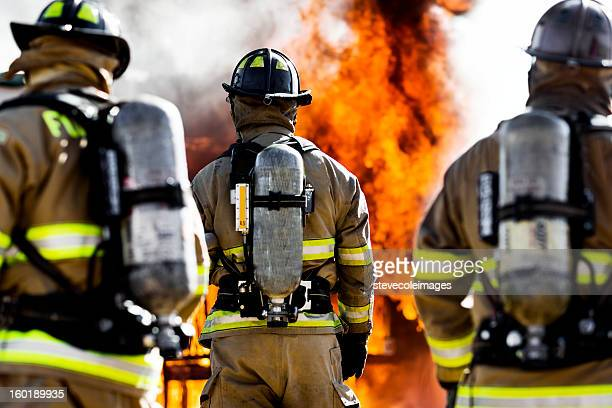 three firefighters - firefighter stock pictures, royalty-free photos & images
