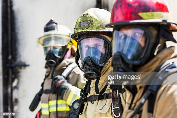 three firefighters wearing oxygen masks - rescue worker stock pictures, royalty-free photos & images