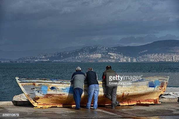 three fishermen watching the scenery. - emreturanphoto - fotografias e filmes do acervo