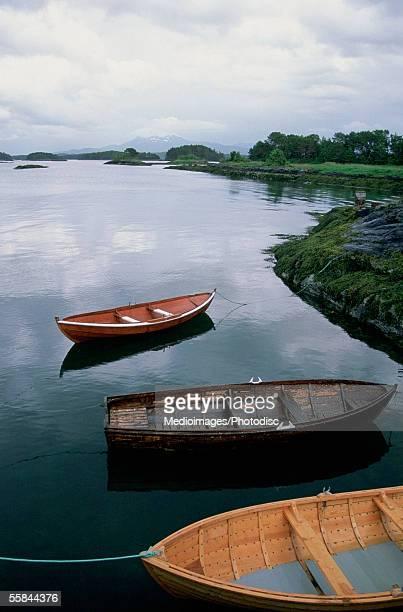 Three fishing boats moored at the beach, Hjertoya Island, Molde, Norway