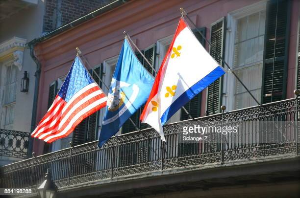 Three flags on a balcony in New Orleans