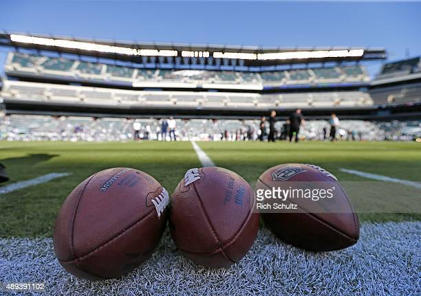 Three footballs sit on the field before a game between the Dallas Cowboys and the Philadelphia Eagles at Lincoln Financial Field on September 20 2015...