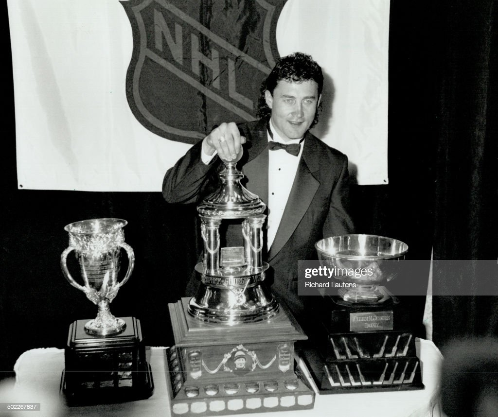 Three for Belfour: Chicago's Ed Belfour poses proudly with haul of hockey hardware collected at last : News Photo