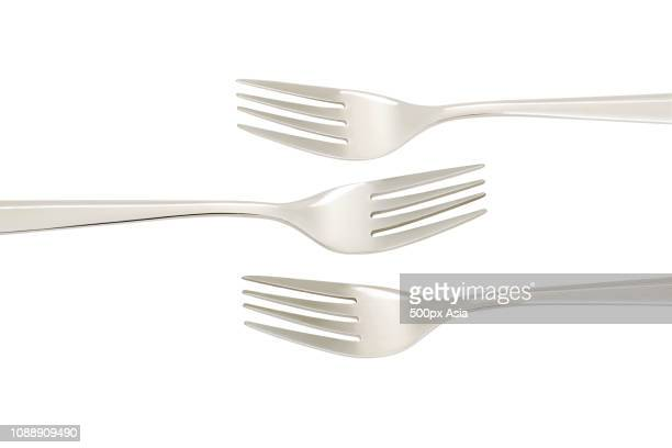 three forks on white background, beijing, china - image stockfoto's en -beelden