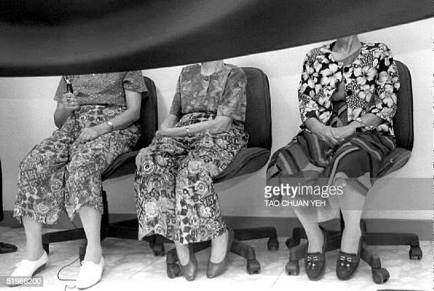 Three former comfort women forced or tricked into prostitution by the Japanese military government during World War II attend a press conference 13...