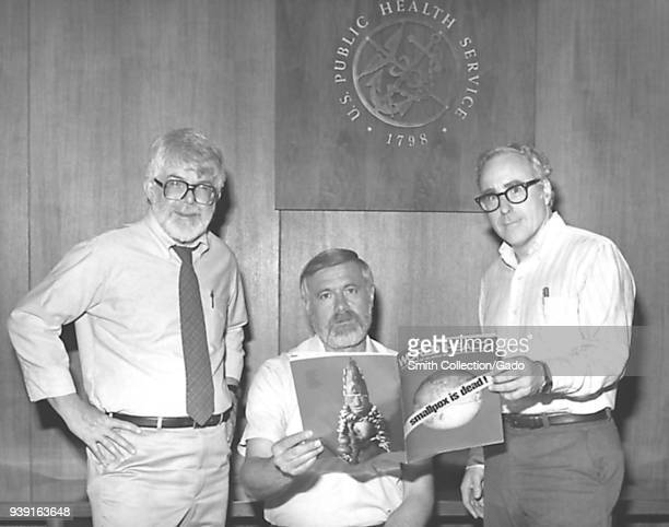 Three former directors of the Global Smallpox Eradication Program, Dr J. Donald Millar, Dr William H. Foege and Dr J. Michael Lane, holding world...