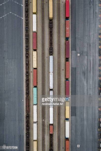 three freight trains photographed from above, bremerhaven, germany - container stock pictures, royalty-free photos & images