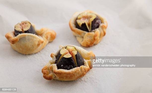 Three fresh figs packed with puff pastry.
