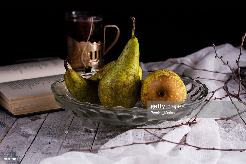 three fresh pears in glass vase on a dark background : Stock Photo