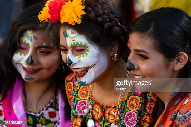 three friends at the día de los muertos festival in oaxaca - sugar skull stock photos and pictures