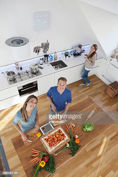 Three friends cooking together, top view