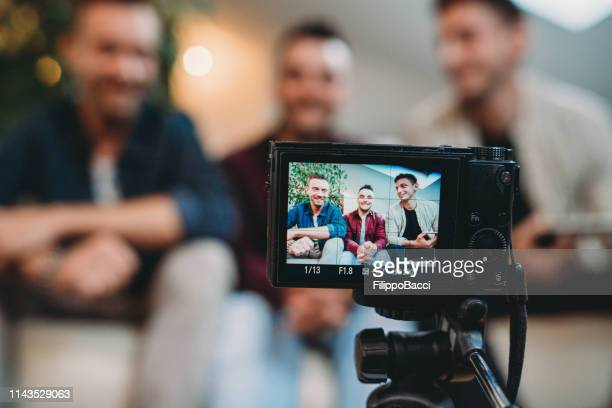three friends doing a vlog video together - television camera stock pictures, royalty-free photos & images