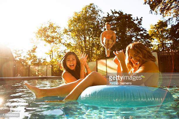 three friends enjoying a day at the pool. - leap day stock pictures, royalty-free photos & images