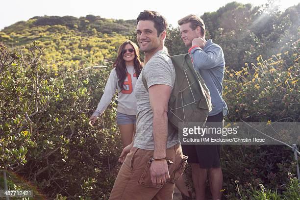 Three friends enjoying walk on vacation