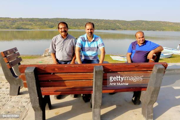 Three friends enjoying weekend on lake
