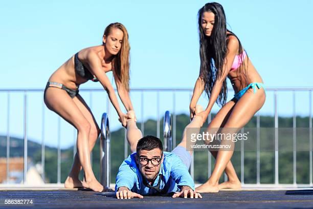 Three friends having fun at swimming pool