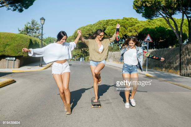 three friends having fun together - ホットパンツ ストックフォトと画像