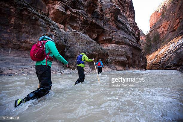 Three friends hiking in Zion.