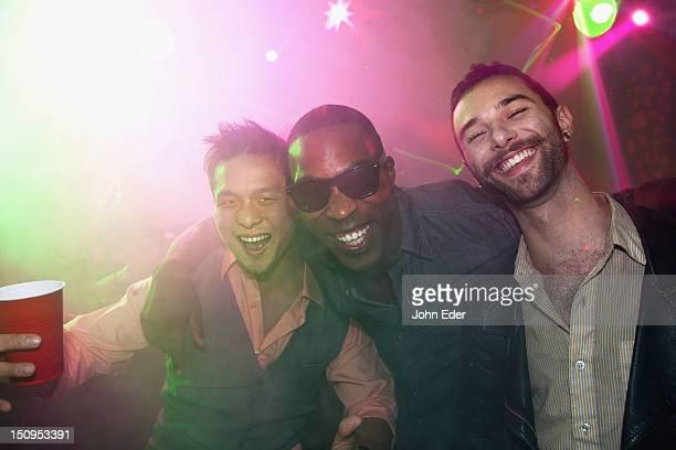 Three friends in a nightclub