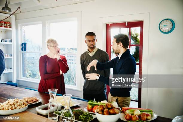 Three friends in discussion before holiday dinner party
