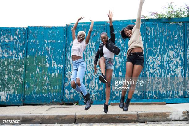 Three friends jumping in the air