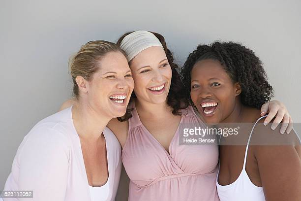 three friends laughing together - large group of people photos et images de collection