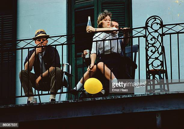 Three friends look down from a balcony in New Orleans 1960