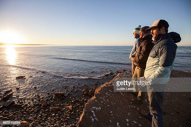 Three Friends on Cliff Gazing at Ocean