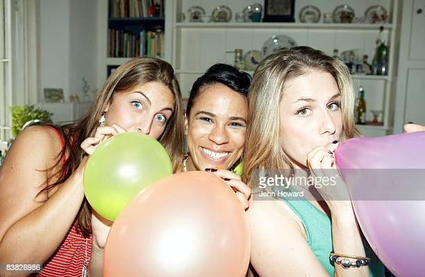 three friends posing with balloons - only young women stock pictures, royalty-free photos & images