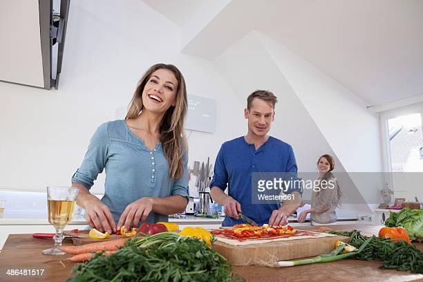 Three friends preparing meal