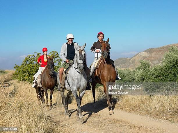 Three friends riding horses